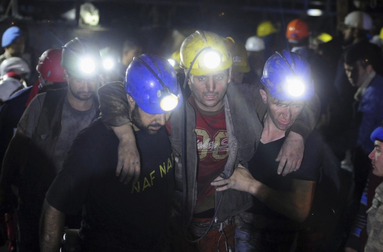 An injured miner is carried to an ambulance after being rescued from a coal mine he was trapped in, in Soma, a district in Turkey's western province of Manisa early. The death toll from an explosion and fire in a Turkish coal mine rose above 200 on Wednesday as rescue workers continued retrieving the dead and injured more than 12 hours after the blast, the country's energy minister said. Hundreds more were still believed to be trapped in the mine in Soma, around 120 km (75 miles) northeast of the Aegean coastal city of Izmir, and the death toll could rise further, Taner Yildiz told reporters at the scene. (Emre Tazegul/Reuters)