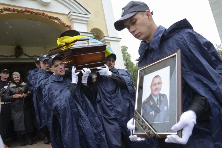 Pallbearers carry the coffin of General Serhiy Kulchytsky during his funeral in Lviv. Kulchytsky was one of 14 servicemen killed when separatists shot down a helicopter in eastern Ukraine on May 29. (Roman Baluk/Reuters)