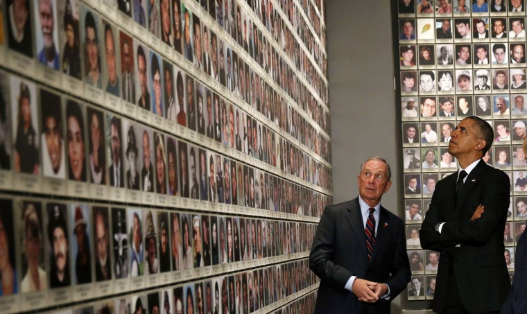 U.S. President Barack Obama (R) and former New York Mayor Michael Bloomberg look at the faces of those who died during the 9/11 attacks at the National September 11 Memorial Museum in New York May 15, 2014. The museum, memorializing the September 11, 2001 attacks, opens this week to victims' family members and next week to the public, displaying artifacts from mangled columns recalling the enormity of that fateful day to shattered eyeglasses recalling its personal pain. (REUTERS/Kevin Lamarque)