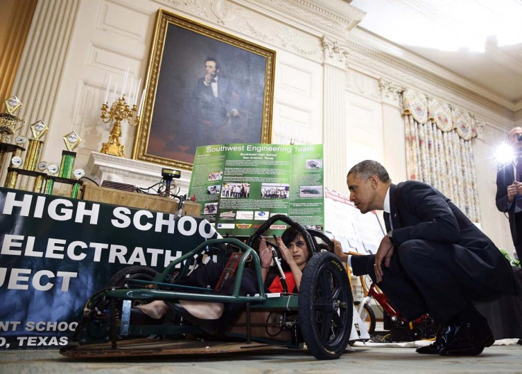 U.S. President Barack Obama listens to Deidre Carillo of San Antonio explain her project while he hosts the 2014 White House Science Fair while in the State Dining Room at the White House in Washington, May 27, 2014. (Larry Downing/Reuters)