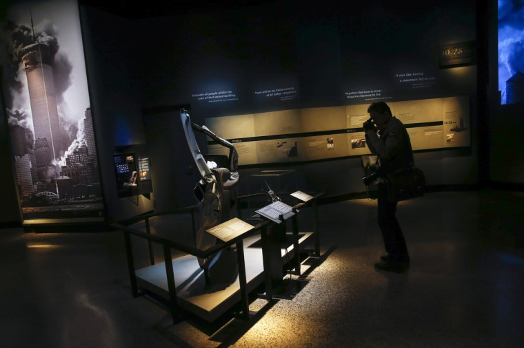 A member of the media take a photo in the historical exhibition section of the National September 11 Memorial & Museum during a press preview in New York. (Shannon Stapleton/Reuters)