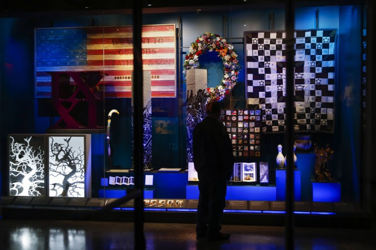 A man stands in the National September 11 Memorial & Museum during a press preview in New York. (Shannon Stapleton/Reuters)