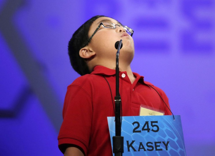 Kasey Torres of San Angelo, Texas exhales after successfully spelling his word during round two of the preliminaries at the Scripps-Howard National Spelling Bee at National Harbor, Maryland May 28, 2014. REUTERS/Gary Cameron
