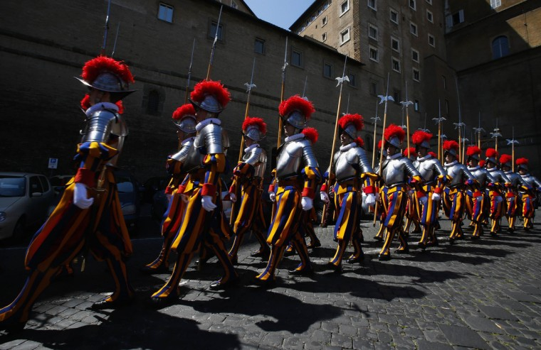 New recruits of the Vatican's elite Swiss Guard march during the swearing-in ceremony at the Vatican. The Swiss Guard, founded in 1506, consist of 100 volunteers who must be of Swiss nationality, Catholic, single, at least 174 cm (5.7 ft) tall and without a beard. New recruits are sworn in every year on May 6 to commemorate the day where 147 Swiss soldiers died defending the Pope during an attack on Rome in 1527. (Tony Gentile/Reuters)