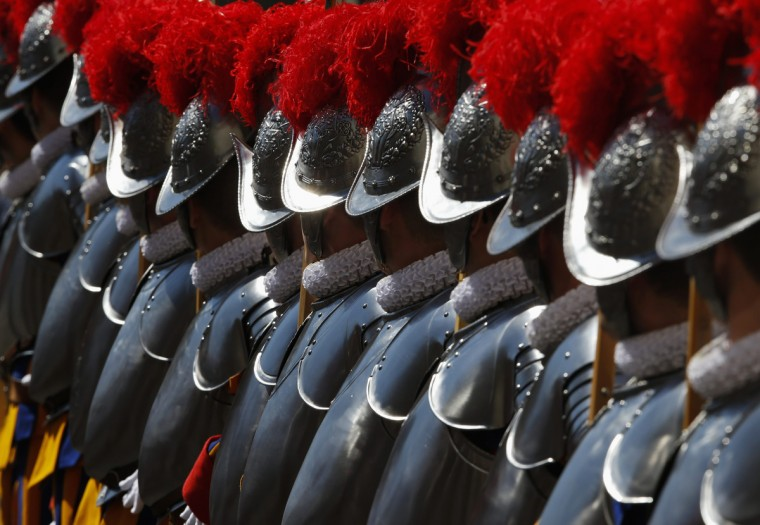New recruits of the Vatican's elite Swiss Guard stand at attention during the swearing-in ceremony at the Vatican. The Swiss Guard, founded in 1506, consist of 100 volunteers who must be of Swiss nationality, Catholic, single, at least 174 cm (5.7 ft) tall and without a beard. New recruits are sworn in every year on May 6 to commemorate the day where 147 Swiss soldiers died defending the Pope during an attack on Rome in 1527. (Tony Gentile/Reuters)