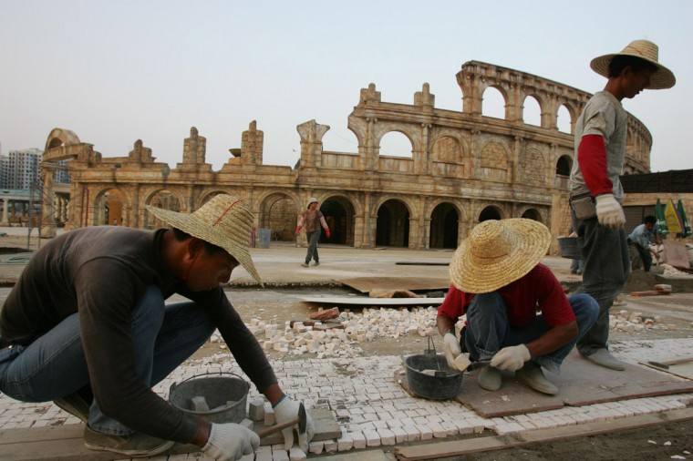 Workers build a pavement outside a replica of the Roman Colosseum at the Fisherman's Wharf, a local invested entertainment park with a casino, which is under construction at the Outer Harbour area in Macau on October 19, 2005. (REUTERS/Paul Yeung)