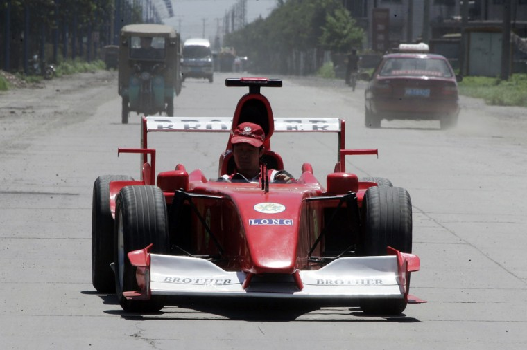 Zhao Xiuguo drives a homemade model of Formula One car in Tangshan, Hebei Province, some 180km (113 miles) east of Beijing on July 21, 2006. Zhao Xiuguo and his brother Zhao Xiushun built the car from scrap metal and said that they wanted to design and build the first Formula One racecar in China. (REUTERS/Claro Cortes IV)