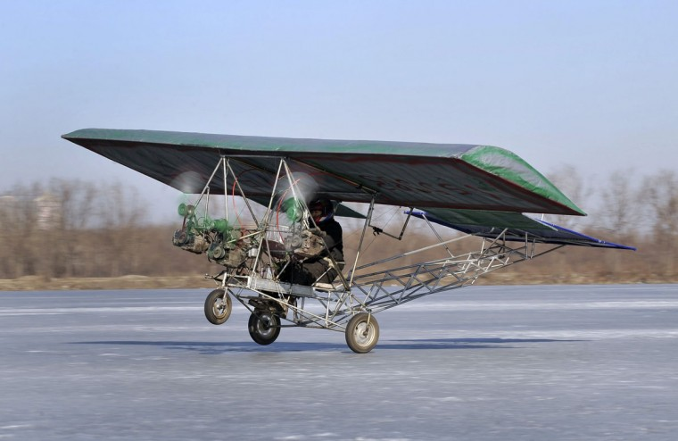 Ding Shilu, an automobile mechanic, carries out a test-flight for his home-made aircraft at a frozen reservoir in Shenyang, Liaoning province on Feb. 25, 2011. The aircraft, which weighs about 130 kg (287 lbs) and is made of recycled materials including three motorbike engines and plastic cloth, costs about 2600 yuan ($395), local media reported. (Reuters photo)