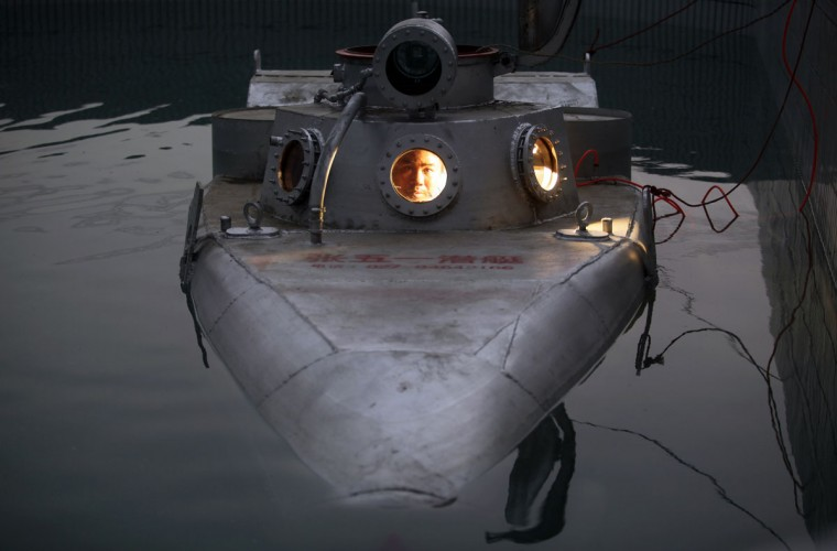 Zhang Wuyi sits in his double-seater submarine during a test operation at an artificial pool near a shipyard in Wuhan, Hubei province on May 7, 2012. Zhang, a 37-year-old local farmer, who is interested in scientific inventions, has made six miniature submarines with several fellow engineers, one of which was sold to a businessman in Dalian at a price of 100,000 yuan ($15,855) last October. The submarines, mainly designed for harvesting aquatic products, such as sea cucumber, have a diving depth of 20-30 meters, and can travel for 10 hours, local media reported. (Reuters photo)