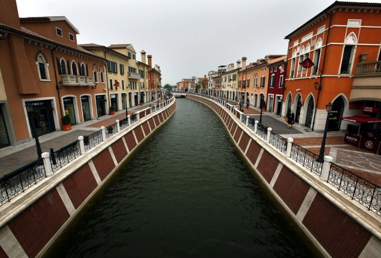 A canal flows through the center of the Florentia Village in the district of Wuqing, located on the outskirts of the city of Tianjin June 13, 2012. The shopping center, which covers an area of some 200,000 square meters, was constructed on a former corn field at an estimated cost of $220 million and copies old Italian-style architecture with Florentine arcades, a grand canal, bridges, and a building that resembles a Roman Coliseum. (REUTERS/David Gray)