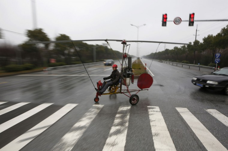 Luo Jinsha operates his home-made aircraft during a test flight on the outskirts of Shanghai on Feb. 26, 2014. Luo, 28, a migrant worker living in Shanghai, spent around eight months and 40,000 yuan ($6,529) to build the plane to fulfill his dream to fly. Despite failing during the first test flight, Luo said he will not give up hope on improving his plane so as to eventually fly it successfully. The aircraft was able to move quickly on the ground but could not take to the air on second attempt. (REUTERS/Aly Song)