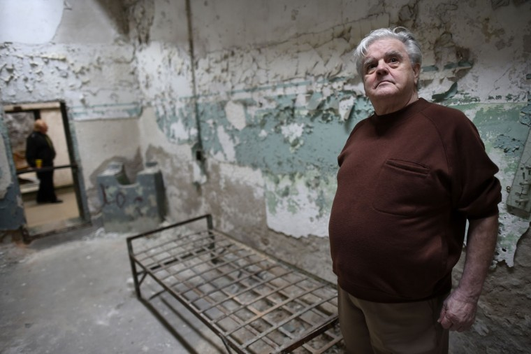 "Jimmy Dolan, 74, a former inmate Eastern State Penitentiary, who served a year and a half for robbery in 1961-62, returns to his cell in block 8. Opened in 1829, with the original corrective system of ""confinement in solitude with labor,"" the penitentiary housed about 75,000 inmates in its 142 years of operation. At Eastern State reunions, former inmates, staff and guard gather to share memories and trade stories and get a chance to describe their experiences in question-and-answer sessions with the public. (REUTERS/Mark Makela)"