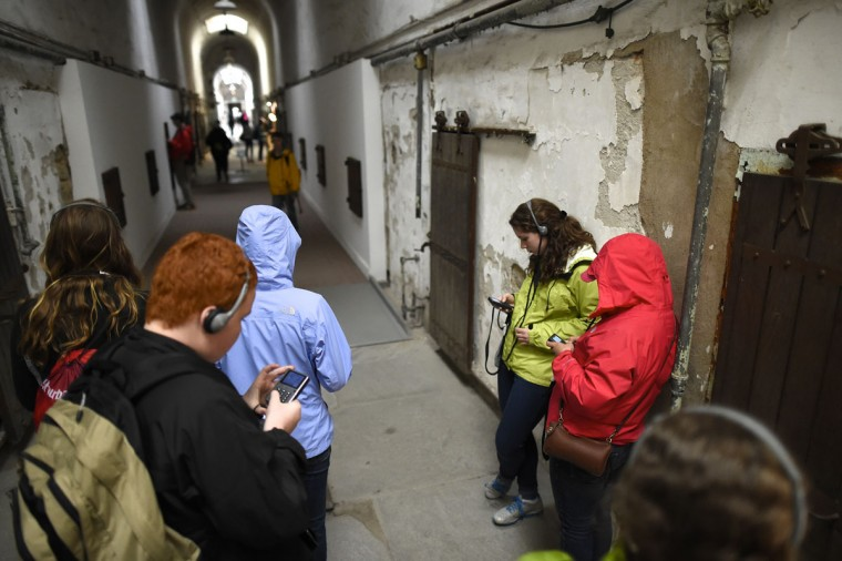 A tour group uses the audio guide through block 9 of the closed Eastern State Penitentiary in Philadelphia. (REUTERS/Mark Makela)