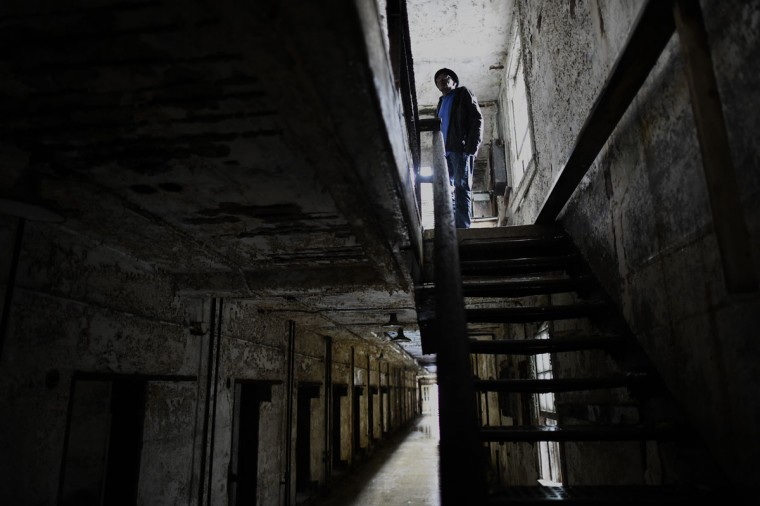 Former inmate at Eastern State Penitentiary, William Harrison, 75, served 3 separate terms (1959, 1962, 1970) for larceny, forgery, and assault, and revisits his prison cell on the second level of block 14 in Philadelphia. (REUTERS/Mark Makela)