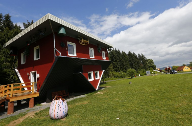 General view of the 'Crazy House', which is completely built upside-down, in the village of Affoldern in Germany. Three friends came up with the idea to build the tourist attraction, which cost about 200,000 euros and took some six weeks to complete. (REUTERS/Kai Pfaffenbach)