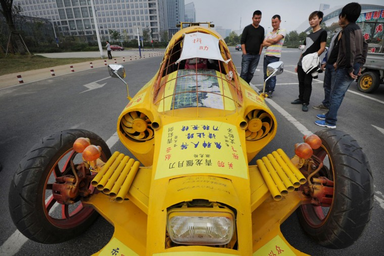 A home-made car built by Zhu Runqiang (not pictured) is seen in Hefei, Anhui province, on Oct. 21, 2013. Grassroots inventor Zhu, 47, built the car with components he collected from used vehicles. The car reaches a highest speed of 60km/h, according to local media. (REUTERS/China Daily)