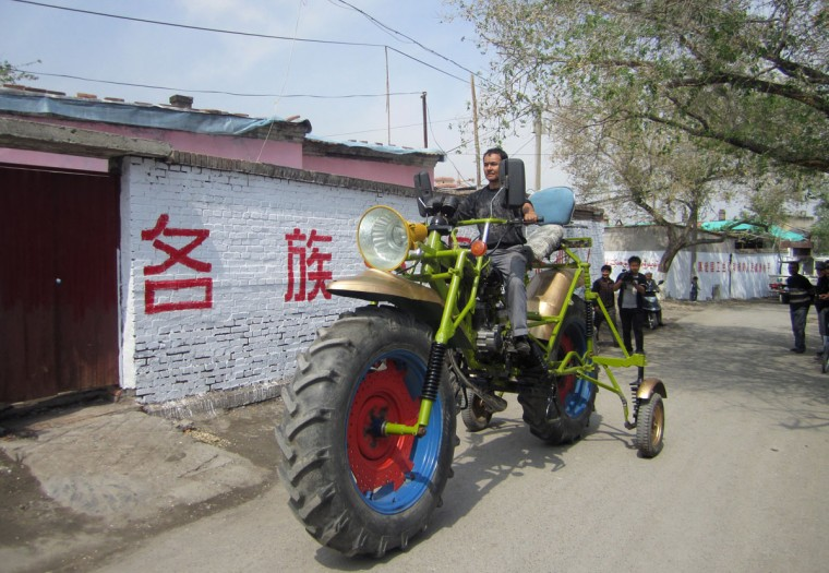 An ethnic Uighur man Abulajon drives his home-made motorcycle during a test in Manas county, Xinjiang Uighur autonomous region, April 27, 2013. Abulajon, a 30-year-old Uighur worker from a sewage treatment plant, spent a year making his 0.3 tonnes motorcycle measuring 4.3 meters (14 feet) in length and 2.4 meters (7.8 feet) in height, although it makes it impossible for him to drive it on the street. It cost him about 8000 yuan ($1300) to buy all the parts from salvage stations and the converted engine can power the motorcycle with a speed of 40 km per hour (24.8 miles per hour), local media reported. (REUTERS/China Daily)