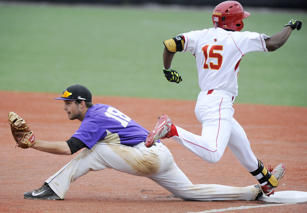 Mount St. Joseph first baseman Sam Rowan, left , forces out Calvert Hall's Troy Stokes in the third inning of a high school baseball game Wednesday, May 14, in Towson. (Steve Ruark, Baltimore Sun Media Group)