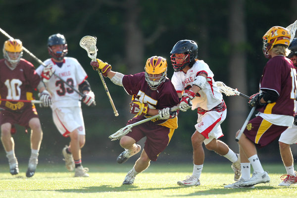 Hereford's Connor Williams, center, controls the ball while being pressured by Glenelg's David Brookhart, right, during the boys lacrosse 3A/2A state semifinal game at Annapolis High School in Annapolis on Friday, May 16. (Jen Rynda, Baltimore Sun Media Group)