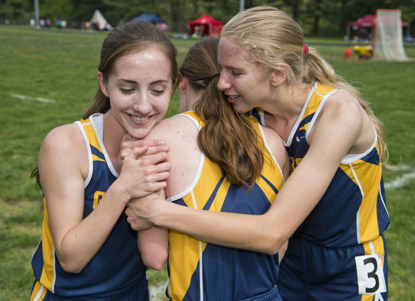 From left, Perry Hall's Anna Ciattri, Julia Ciattei and Michelle Krach celebrate their performance in the 4x800-meter relay during the Baltimore County Track and Field Championships at Pikesville High School in Pikesville on Saturday, May 10. (Scott Serio, Baltimore Sun Media Group)