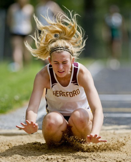 Hereford's McKenzie Clark makes a landing while competing in the triple jump during the Baltimore County Track and Field Championships at Pikesville High School in Pikesville on Saturday, May 10. (Scott Serio, Baltimore Sun Media Group)