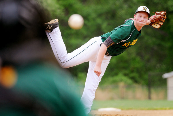 Saint John's pitcher Michael Bealmear fires one down the line toward a Chapelgate batter during a game at Chapelgate High School in Marriottsville on Thursday, May 15. (Jon Sham, Baltimore Sun Media Group)