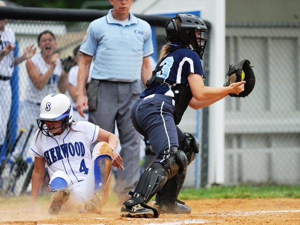 The throw home to Howard catcher Alli Jakubek, right, is a few seconds too late as Sherwood's Hannah Nalls slides safely onto the plate during a regional playoff game at Sherwood High School in Sandy Spring on Wednesday, May 14. (Jon Sham, Baltimore Sun Media Group)