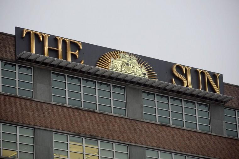 The Baltimore Sun building facing Guilford Avenue. (Karl Merton Ferron/Baltimore Sun)