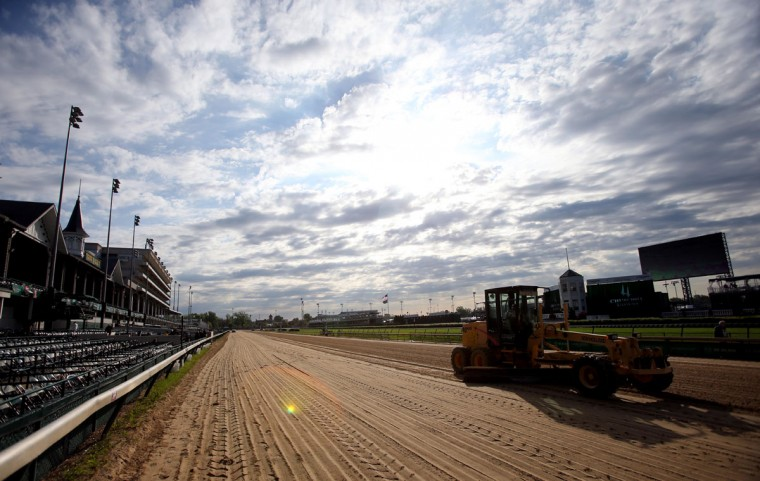 Tractors rake the track before the 2014 Kentucky Derby at Churchill Downs. (Jerry Lai-USA TODAY Sports)
