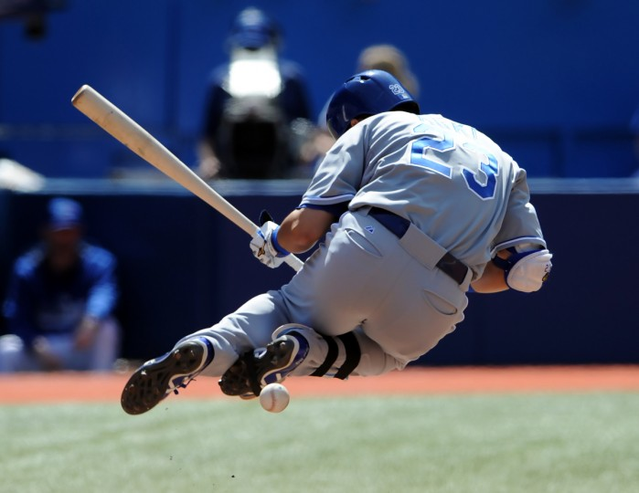 Kansas City Royals right fielder Nori Aoki is struck by a pitch from Toronto Blue Jays relief pitcher Todd Redmond (not pictured) in the seventh inning at Rogers Centre. (Dan Hamilton/USA TODAY Sports)
