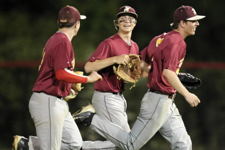 Hereford's Parker Lenivy, center, runs in with his teammates after making a catch for an out during the baseball state semifinal game against Southern at Montgomery Blair High School. (Jen Rynda/BSMG)