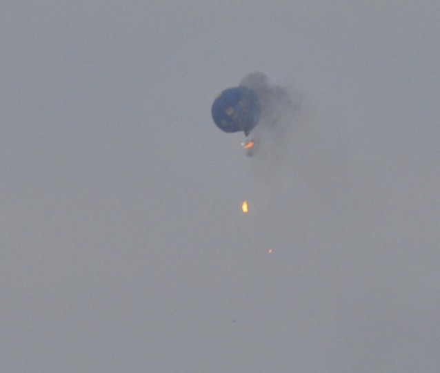 A hot air balloon on fire is pictured north of Richmond, Virginia, in this handout photo courtesy of Lynn Shultz. At least one person died and two were missing after the hot air balloon hit a power line and caught fire over Virginia during a festival, police said on Saturday. Authorities said they had found the remains of one person, and were continuing to search for the others missing after the Friday evening accident 30 miles north of Richmond. (Lynn Shultz/Handout via Reuters)
