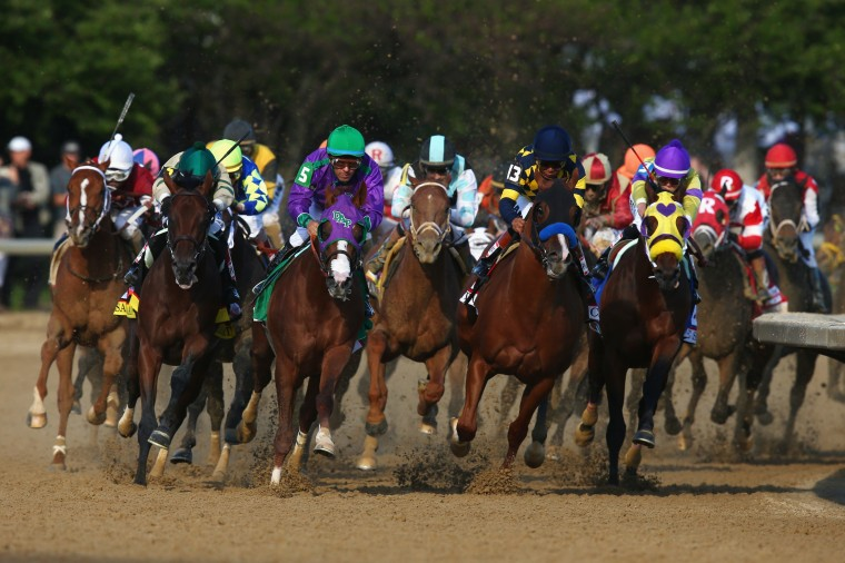 California Chrome (5,) ridden by Victor Espinoza, leads the field out of the fourth turn enroute to winning the 140th running of the Kentucky Derby at Churchill Downs in Louisville, Ky. (Andy Lyons/Getty Images)