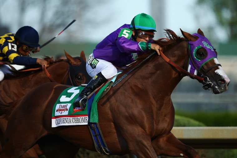 California Chrome (5,) ridden by Victor Espinoza, pulls away from Chitu (13,) ridden by Martin Garcia, coming out of the fourth turn enroute to winning the 140th running of the Kentucky Derby at Churchill Downs in Louisville, Ky. (Andy Lyons/Getty Images)