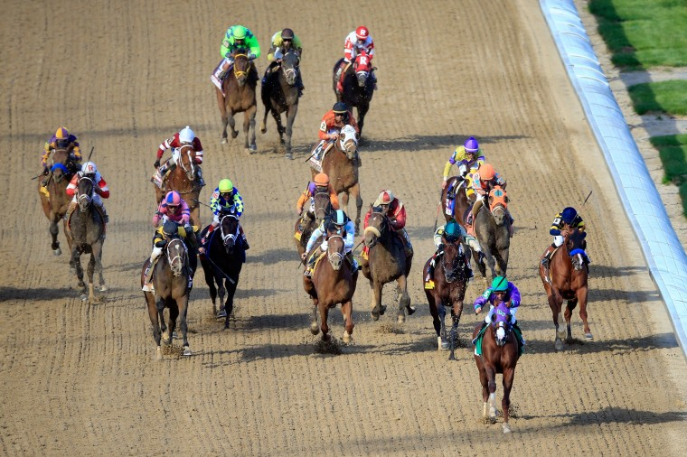 California Chrome with Victor Espinoza leads the field to the finish line to win the 140th running of the Kentucky Derby at Churchill Downs in Louisville, Ky. (Jamie Squire/Getty Images)