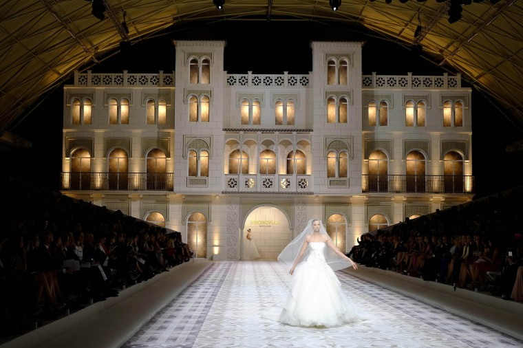 A model walks the runway for the Pronovia's 50th anniversary bridal fashion show during 'Barcelona Bridal Week 2014 in Barcelona, Spain. (Miquel Benitez/Getty Images)