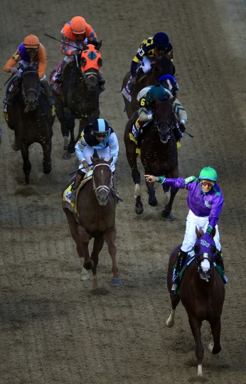 California Chrome with Victor Espinoza up crosses the finish line to win the 140th running of the Kentucky Derby at Churchill Downs in Louisville, Ky. (Jamie Squire/Getty Images)