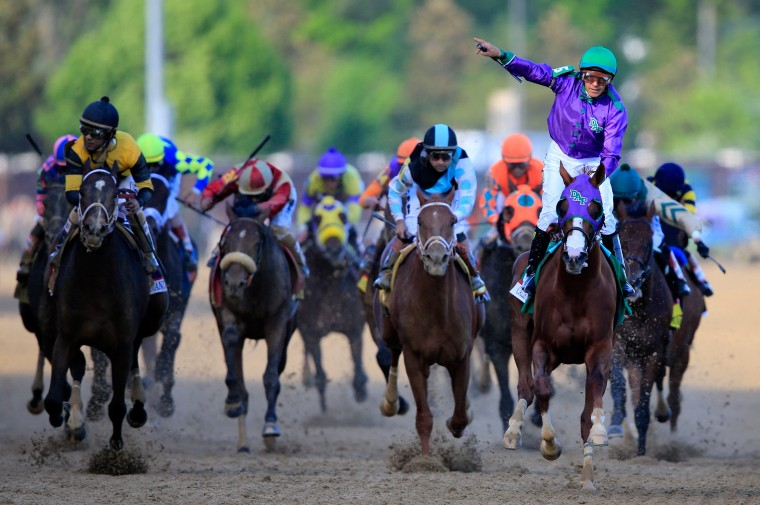 California Chrome (5,) ridden by Victor Espinoza, crosses the finish line to win the 140th running of the Kentucky Derby at Churchill Downs in Louisville, Ky. (Rob Carr/Getty Images)