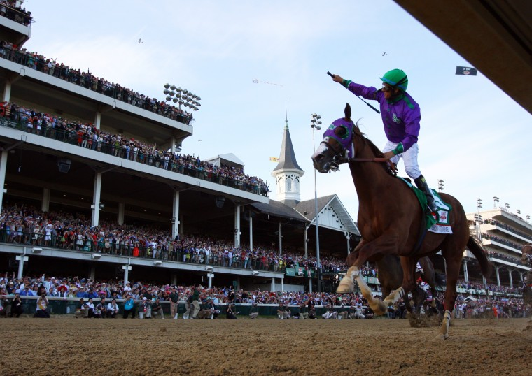 California Chrome jockey Victor Espinoza (5) celebrates winning the 2014 Kentucky Derby at Churchhill Downs in Louisville, Ky. (Brian Spurlock/USA Today Sports)