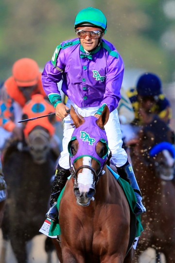 Jockey Victor Espinoza celebrates atop of California Chrome (5) after crossing the finish line to win the 140th running of the Kentucky Derby at Churchill Downs in Louisville, Ky. (Rob Carr/Getty Images)