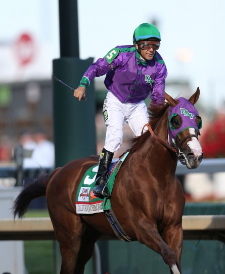California Chrome jockey Victor Espinoza celebrates winning the 2014 Kentucky Derby at Churchill Downs in Louisville, Ky. (Mark Zerof/USA Today Sports)