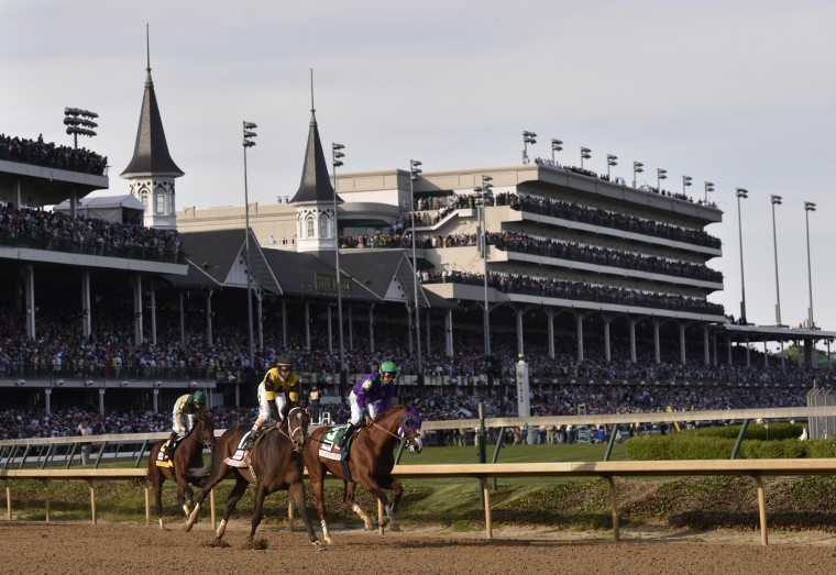 Victor Espinoza aboard California Chrome (5) takes a victory lap after winning the 2014 Kentucky Derby at Churchill Downs in Louisville, Ky. (Jamie Rhodes/USA Today Sports)