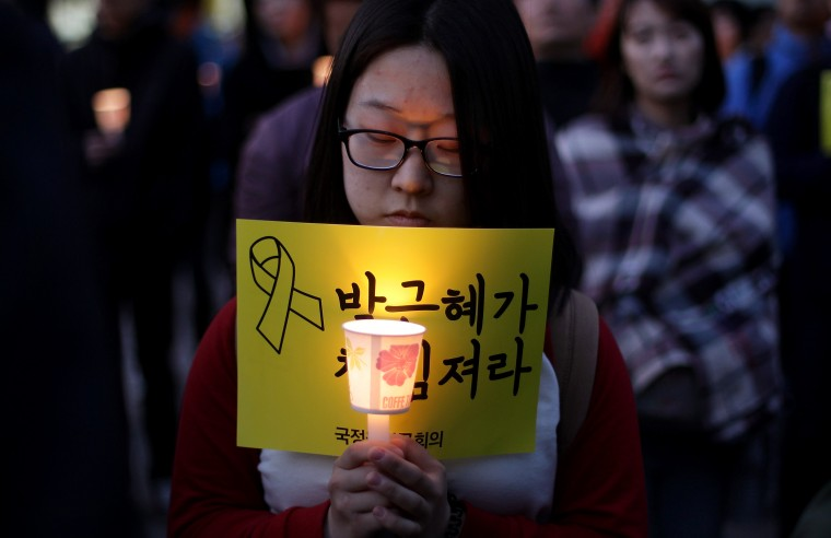 People gather and pray for the safe return of missing passengers and for the victims of the sunken ferry Sewol in Seoul, South Korea. On April 16 the Sewol ferry carrying 476 passengers sunk off the island of Jindo. More than 302 passengers are dead or missing and the cause of the accident is still under investigation. (Chung Sung-Jun/Getty Images)