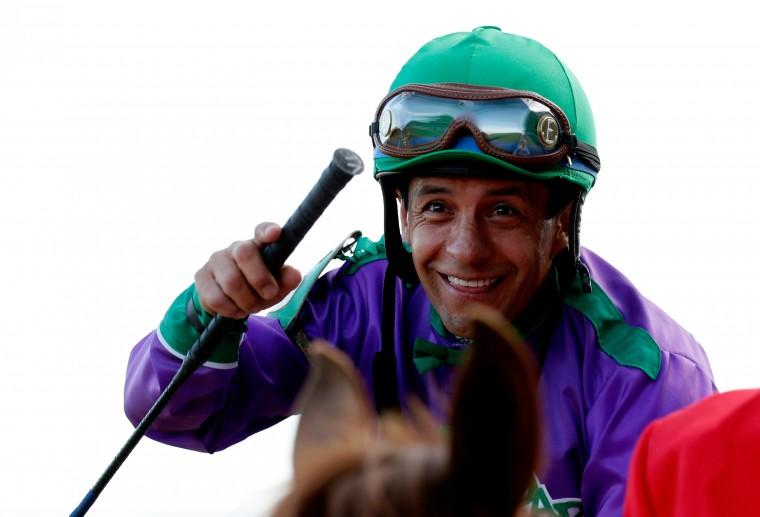 Jockey Victor Espinoza celebrates atop of California Chrome (5) after crossing the finish line to win the 140th running of the Kentucky Derby at Churchill Downs in Louisville, Ky. (Kevin C. Cox/Getty Images)