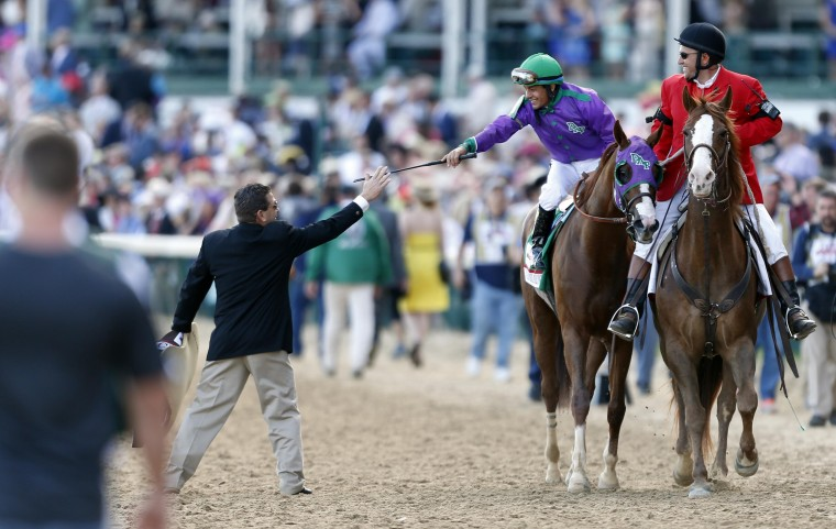 Victor Espinoza aboard California Chrome (5) celebrates after winning the 2014 Kentucky Derby at Churchill Downs in Louisville, Ky. (Brian Spurlock/USA Today Sports)