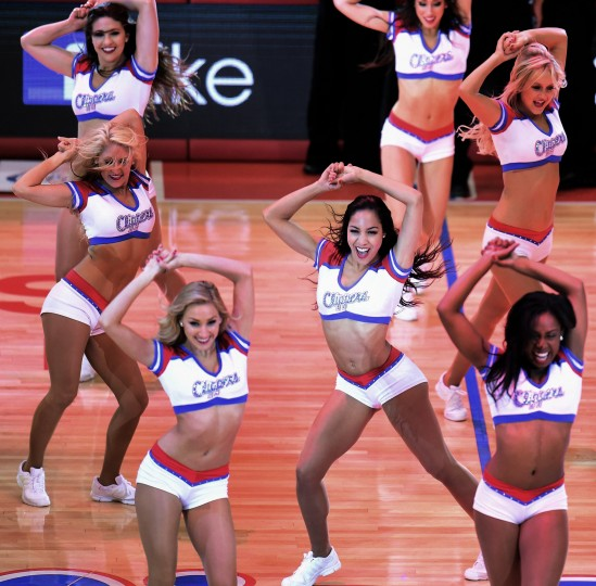Cheerleaders of the Los Angeles Clippers entertain fans between the action against the Oklahoma City Thunder on May 9, 2014 at Staples Center in Los Angeles, California, during game 3 of their NBA playoff round two series in which the Thunder defeated the Clippers 118-112. (Frederic J. Brown/AFP-Getty Images)