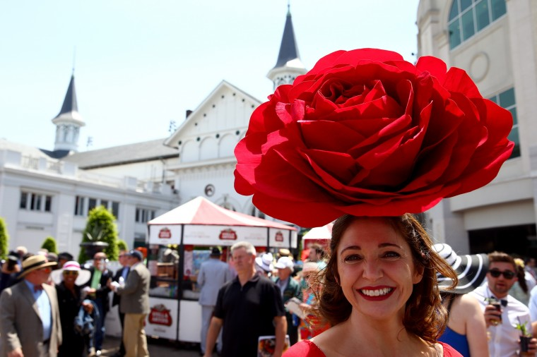 A race fan wearing a festive hat attends the 140th running of the Kentucky Derby at Churchill Downs in Louisville, Kentucky. (Andy Lyons/Getty Images)