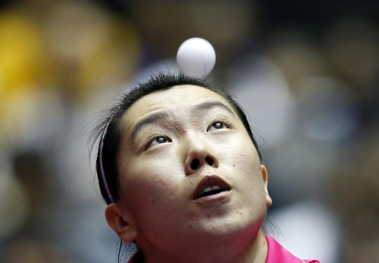 China's Li Xiaoxia eyes the ball as she serves to North Korea's Ri Mi Gyong during their women's quarter-final match at the World Team Table Tennis Championships in Tokyo. (Toru Hanai/Reuters)