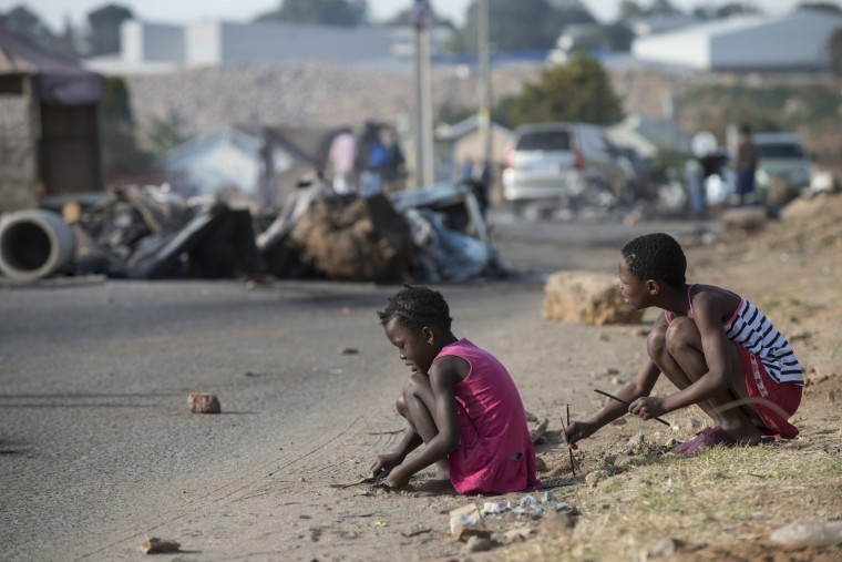 Children play in Alexandra township in Johannesburg, South Africa, one day after the army was deployed to quell violence following elections that returned Nelson Mandela's ANC to power. The unrest reportedly follows allegations of vote-rigging in the area during Wednesday's general polls, which marked 20 years of democracy since the end of apartheid. (Mujahid Safodien/AFP-Getty Images)