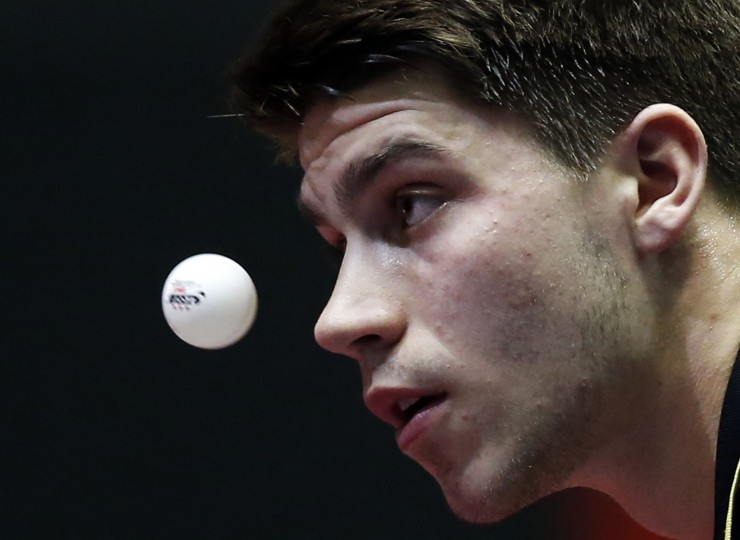 Germany's Patrick Franziska eyes the ball as he serves to Singapore's Pang Xuejie during their men's quarter-final match at the World Team Table Tennis Championships in Tokyo. (Toru Hanai/Reuters)